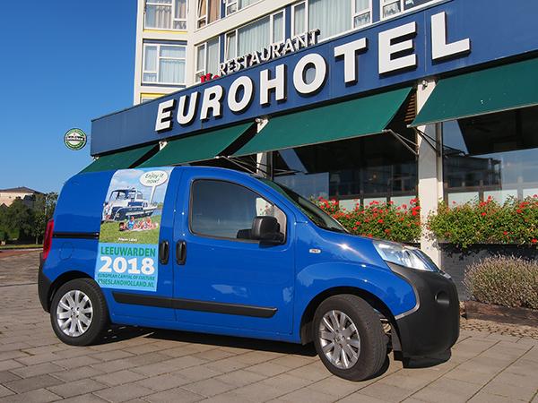 Eén van Friesland Holland's promotiewagens met reclame voor Leeuwarden Friesland 2018.